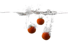 Fresh tomatoes. Splashing on water Royalty Free Stock Images