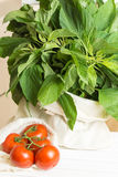 Fresh tomatoes and amaranthus blitum in eco cloth bag Royalty Free Stock Photography