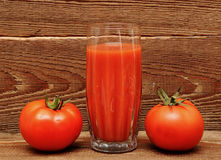 Fresh Tomatoes And A Glass Full Of Tomato Juice Stock Image