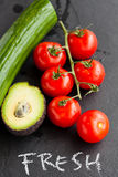 Fresh tomatoes and avocado and cucumber Royalty Free Stock Photos