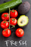 Fresh tomatoes and avocados and cucumber Stock Images