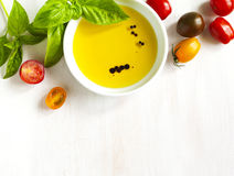 Fresh tomatoes, basil, olive oil with balsamic vinegar. On wooden background with copy space stock photo
