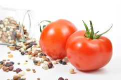 Fresh tomatoes and bean Stock Images