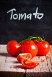 Fresh tomatoes and blackboard Royalty Free Stock Photos