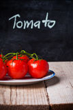 Fresh tomatoes and blackboard Stock Photo
