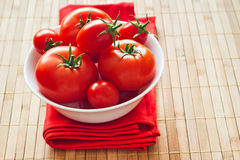 Fresh tomatoes in bowl Stock Images