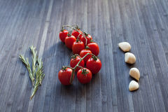 Fresh tomatoes on a branch Stock Photo