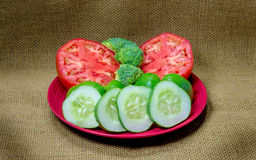 Fresh Tomatoes, Broccoli, Green Peppers and Sliced Cucumbers Royalty Free Stock Photography