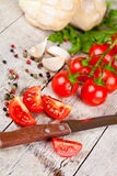 Fresh tomatoes, buns, spices and old knife Royalty Free Stock Photos