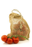 Fresh tomatoes in a burlap bag Stock Photos