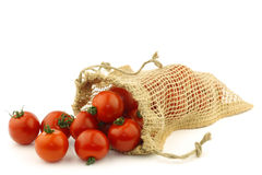 Fresh tomatoes in a burlap bag Stock Photography