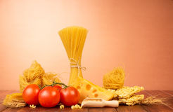 Fresh tomatoes, cheese and pasta on brown Royalty Free Stock Photo