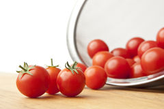 Fresh Tomatoes in Colander on Cutting Board Royalty Free Stock Images