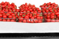 Fresh tomatoes in containers. At market Royalty Free Stock Image