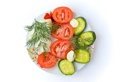 Fresh tomatoes, cucumbers, garlic and herbs Royalty Free Stock Images