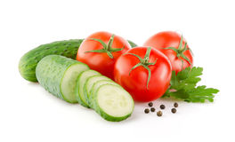 Fresh Tomatoes, Cucumbers and Parsley on white Royalty Free Stock Photos