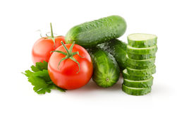 Fresh Tomatoes, Cucumbers and Parsley on white Stock Images