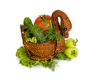 Fresh tomatoes, cucumbers, pepper in a wooden vase Royalty Free Stock Photography