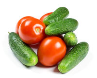 Fresh tomatoes and cucumbers. On white background Stock Photos
