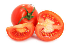 Fresh tomatoes with cut on white background Royalty Free Stock Photos