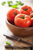 Fresh tomatoes on cutting board Stock Photo