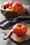 Fresh tomatoes on cutting board Stock Photography