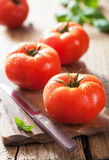 Fresh tomatoes on cutting board Royalty Free Stock Photo