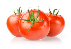 Fresh Tomatoes with Drops. Tomatoes with Drops  on White Background Royalty Free Stock Photography