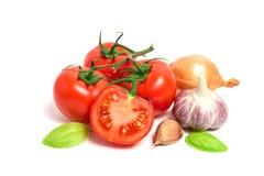 Fresh tomatoes, garlic and onion isolated on white background Stock Photo