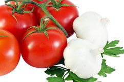Fresh tomatoes and garlic with parsley Royalty Free Stock Photography