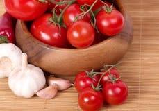 Fresh tomatoes with garlic Stock Photos
