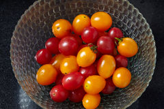 Fresh tomatoes in glass bowl Stock Image