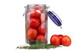 Fresh tomatoes in a glass jar. With a variety of spices Stock Images