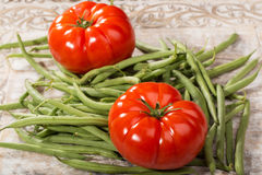 Fresh tomatoes and green beans Royalty Free Stock Photos