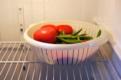 Fresh tomatoes and green beans in refrigerator Stock Photography