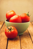 Fresh tomatoes in green bowl Stock Photo