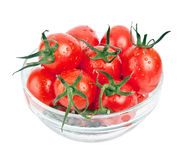 Fresh tomatoes with green leaf in plate. Isolated on white background Royalty Free Stock Images