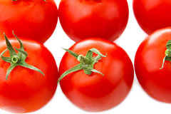 Fresh tomatoes with green leaves isolated on white background Stock Photo