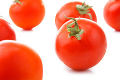 Fresh tomatoes with green leaves isolated on white background Royalty Free Stock Photos