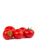 Fresh tomatoes with green leaves isolated on white background. Some fresh tomatoes with green leaves isolated on white background stock image