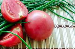 Fresh tomatoes and green onions Royalty Free Stock Photos
