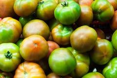 Fresh tomatoes heap in market Royalty Free Stock Photos