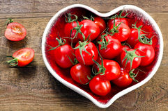 Fresh tomatoes in a heart shaped plate. Healthy food. Royalty Free Stock Images