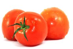 Fresh tomatoes isolated on white. With drops of water Royalty Free Stock Images