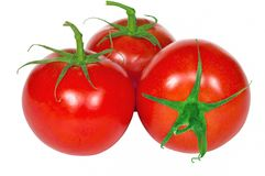 Fresh tomatoes isolated on the white background Royalty Free Stock Photos