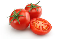 Fresh tomatoes. Isolated on white background. Macro shot