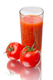 Fresh tomatoes and juice Royalty Free Stock Photo