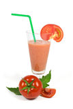 Fresh tomatoes juice in glass cup with green tube and sliced tomatoes isolated on white Stock Photo