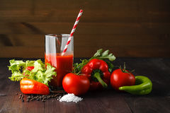 Fresh tomatoes juice with herb on rustic wooden table Stock Photography