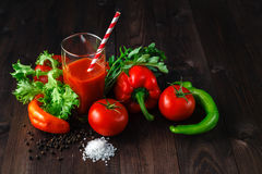 Fresh tomatoes juice with herb on rustic wooden table Royalty Free Stock Photos